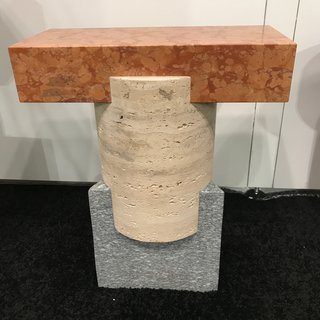 A Tuscan Stool made in Italy by Oevffice for Matter, handcrafted from three different stones: Rosso Verona Marble, Roman Travertine, and Luzerna stone.