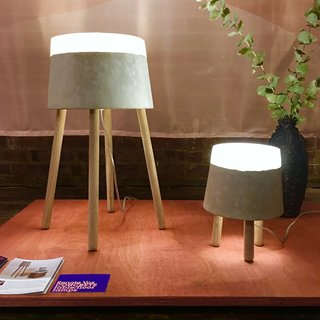 At WantedDesign, we spotted these winning Concrete table lamps by Renate Vos. Illuminated by LED, these pieces are comprised of concrete, silicone, and oak.
