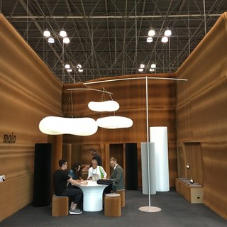 Molo, based in Vancouver, brought their ingenious booth system to ICFF. The walls are constructed of paper, and once the show concludes, it folds up for travel back to the studio. The cloud-like pendants are counter-balanced by hanging weights.
