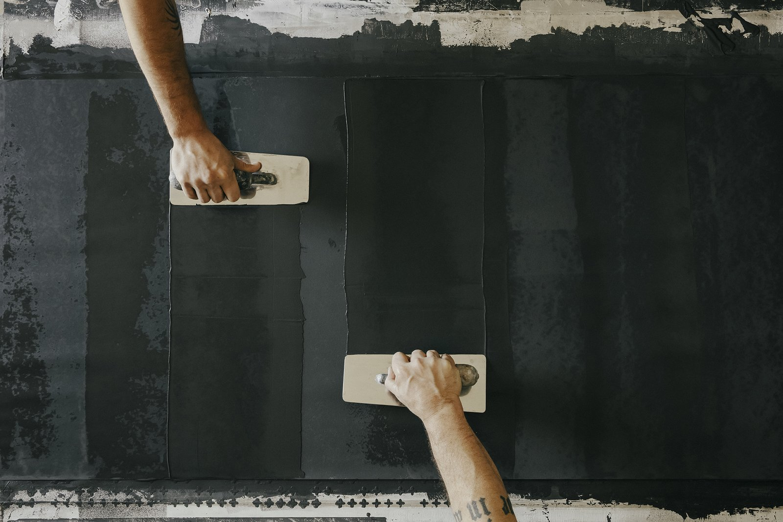 Coat:  Using traditional Italian plaster trowels,  the team applies a base coat of plaster that has been  mixed with marble dust.  Photo 7 of 17 in Paper Trail