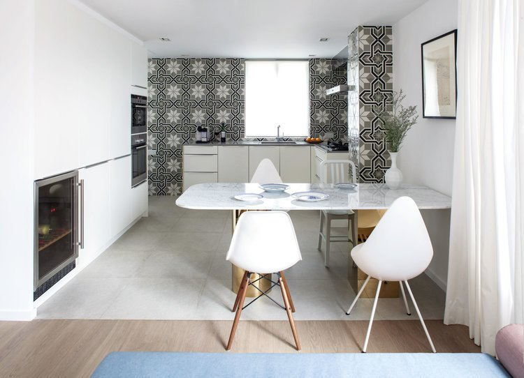 Dining Room, Chair, Table, Recessed Lighting, Cement Tile Floor, and Medium Hardwood Floor  Photo 2 of 7 in See How This Colorful Hong Kong Apartment Was Made to Feel Bigger Than it Actually Is
