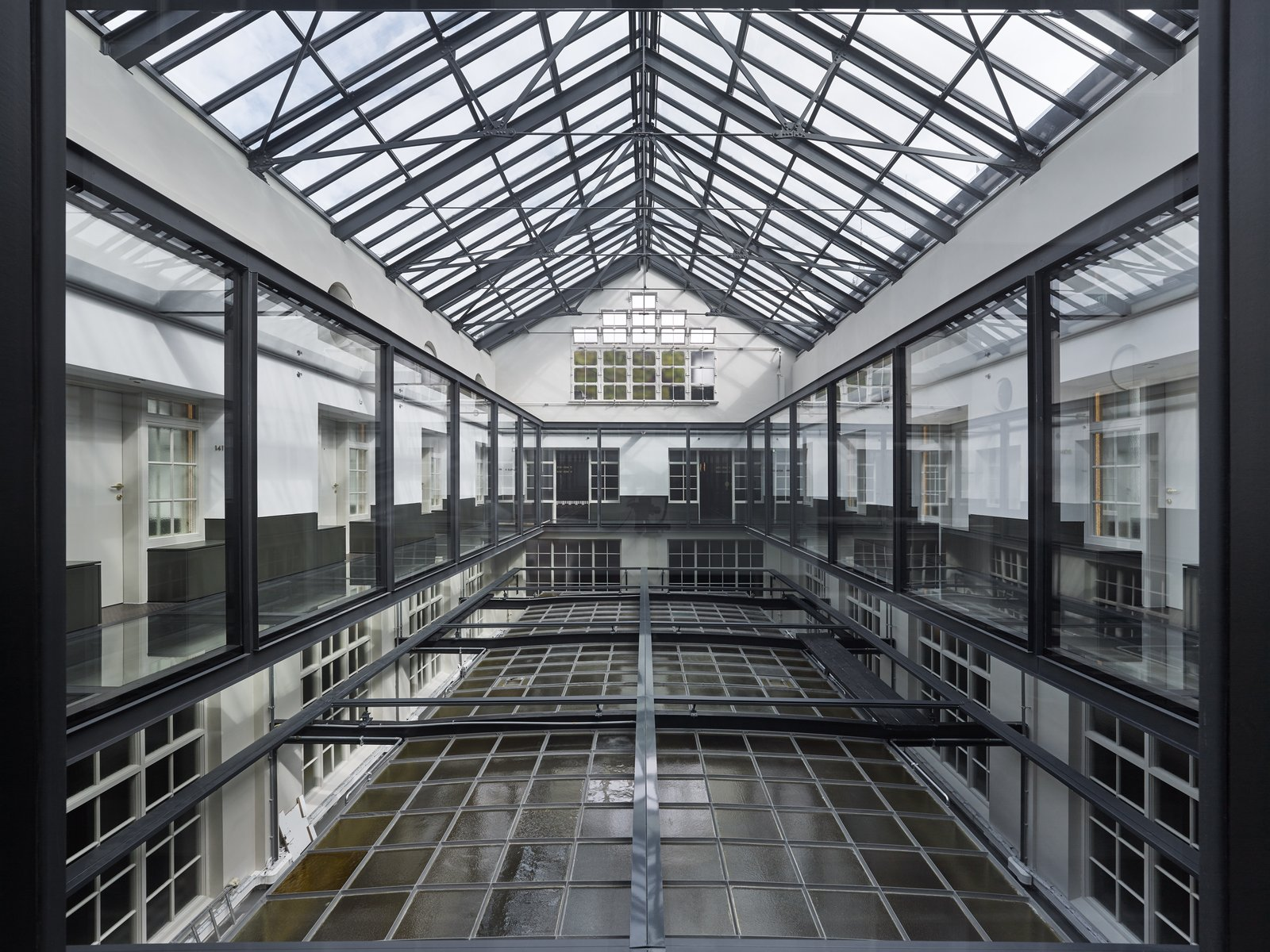 Windows, Metal, and Skylight Window Type A glass bridge traverses the atrium.  Photo 5 of 14 in Formerly a Historic Bank, This Amsterdam Hotel Honors its Stately Roots