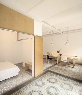 11 Examples of How to Incorporate Traditional Building Materials Into Your Modern Home - Photo 2 of 12 - A renovated apartment in the Catalan city of Barcelona preserved the existing historic cement tiles, which maintains the original room layout in the home.
