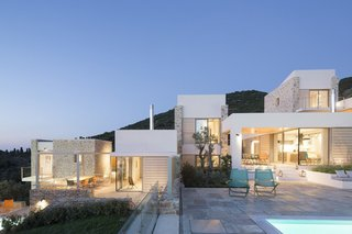 10 Modernist Beach Home Rentals to  Escape to This Summer - Photo 1 of 10 - Designed by architect Nikitas Hatzimichalis, these villas are designed to work in harmony with the complex topography of a lush Greek island on the Aegean Sea. It effectively highlights views of the Skiathos beaches and coast of Pelion. Each villa has its own swimming pool that overlooks the sea, and is ensconced by green verandas for added privacy.