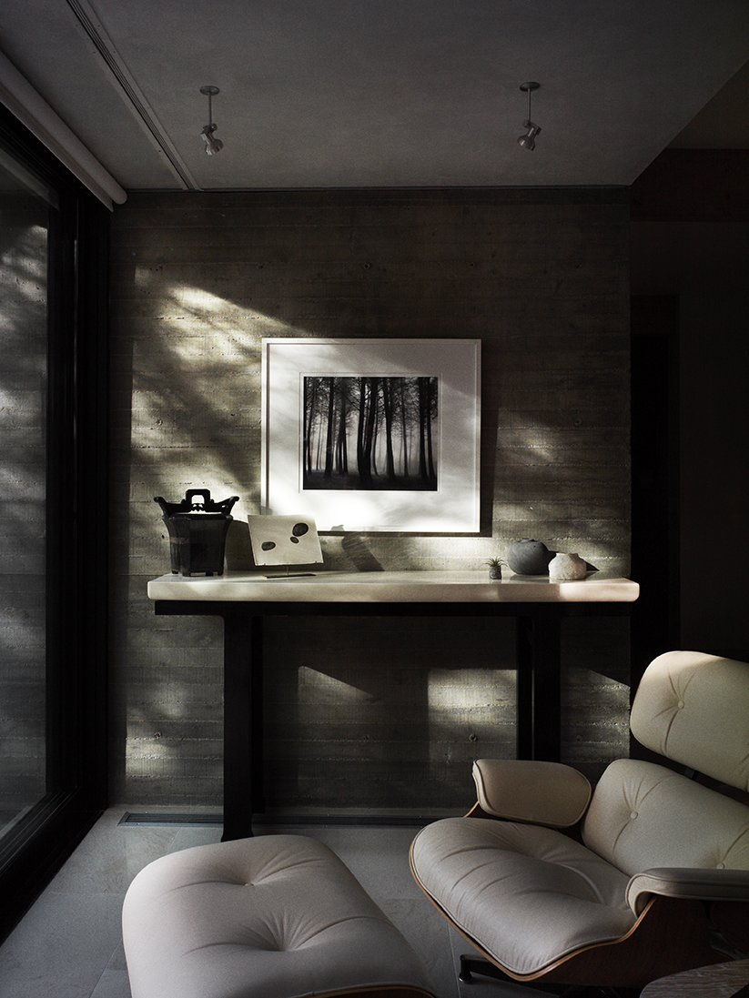 Living Room, Recliner, Console Tables, Chair, and Ceiling Lighting The lacquered console is by Robert Kuo.  Photo 7 of 15 in In Praise of Shadows