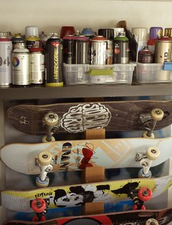 In the music room, skateboards are stored below spray paints the family and friends use to decorate the skate bowl.