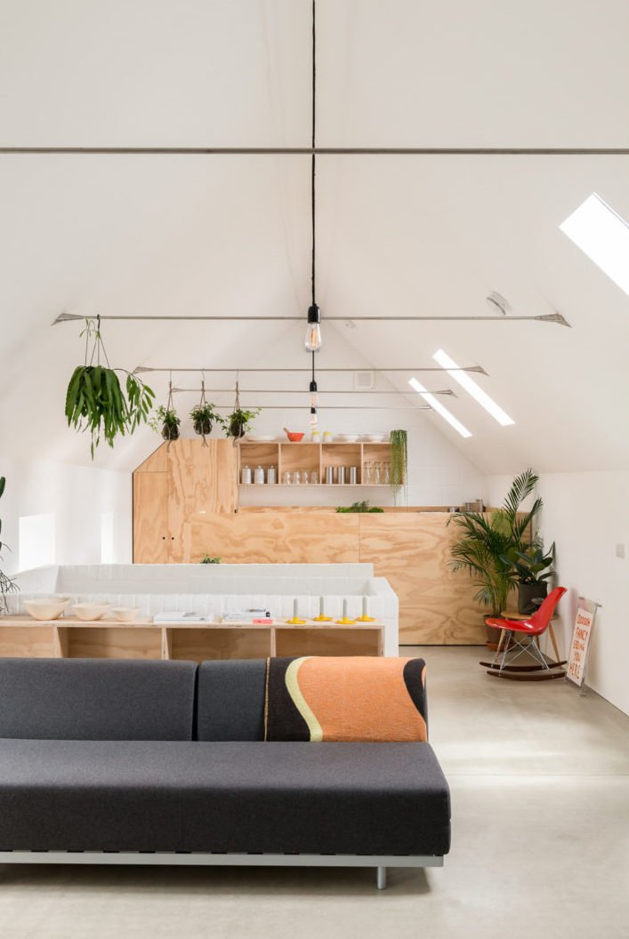 Living Room, Pendant Lighting, Sofa, and Concrete Floor  Salthouse from Formerly a Farm Workers' Cottage, This Cool Norfolk Home Costs Just Over $1 Million