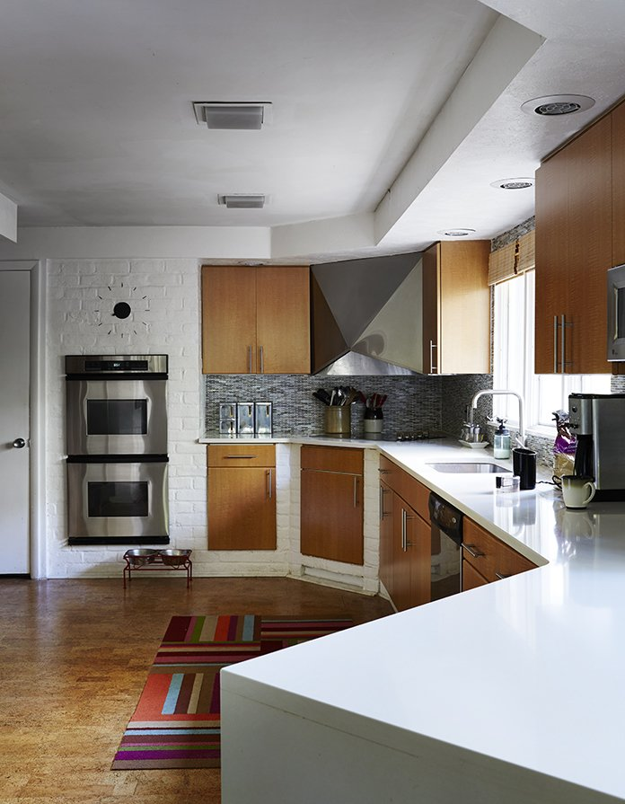 Kitchen, Undermount Sink, Wood Cabinet, and Engineered Quartz Counter The residents added double-glaze windows, low-VOC paints, and Energy Star appliances, calling on help just once, to install the Cambria quartz countertop in the kitchen.  Photo 3 of 13 in How to Update a Midcentury Modern Gem