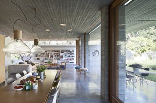 An Architect's Bright and Airy Family Home Thrives Within a Brutalist Concrete Structure - Photo 2 of 12 -
