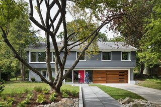 """""""We looked at so many colonials and couldn't imagine what we'd do with all the tiny rooms,"""" says Dianne Bruning, who with her husband, David Owen, enlisted architect Lou Balodemas to update a 1968 home outside of Chevy Chase, Maryland."""