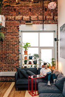 """Inside his San Francisco living room, Max Heinritz kicks back on a Söderhamn sectional from IKEA. """"In Tokyo, everything is space-efficient, nothing is wasted,"""" he says. """"I'm sort of going for that, too."""""""