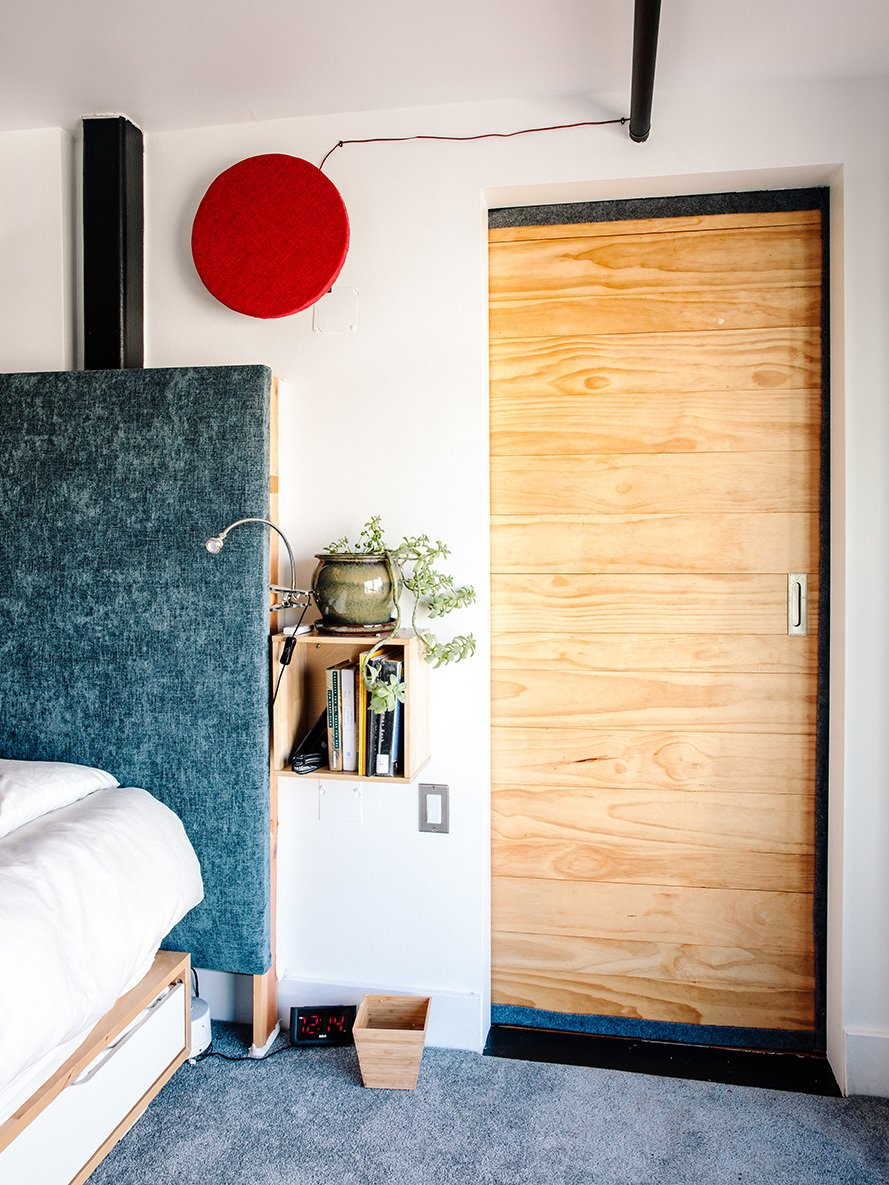 Bedroom, Carpet Floor, and Bed For his bedroom, Max designed a custom headboard insulated with several layers of cotton and upholstery fabric to reduce sound.  Photo 5 of 11 in Devising Clever Solutions For a Small San Francisco Loft