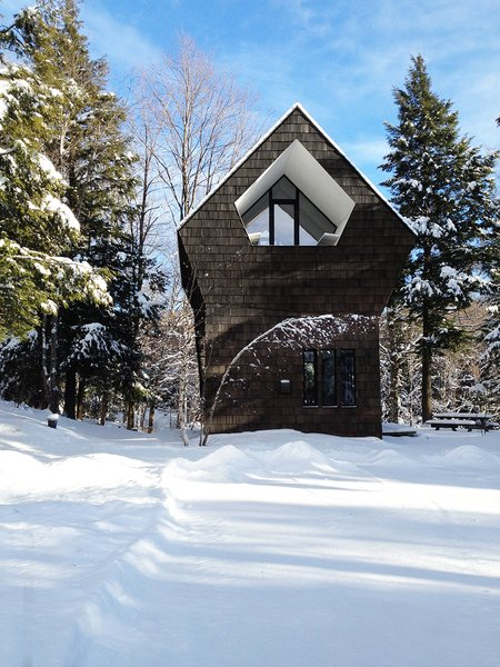 The new 1,300-square-foot home is tucked away in southeastern Quebec.