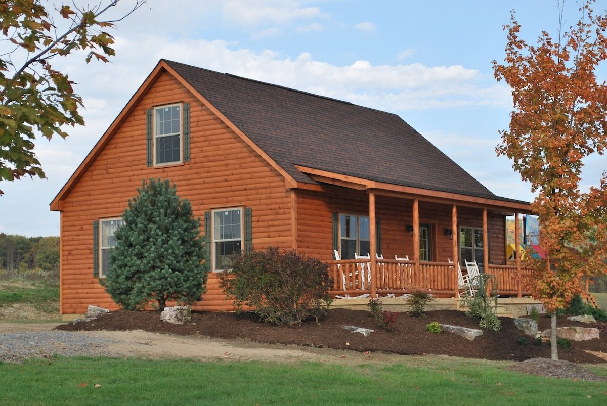 Shawnee Structures offers log homes featuring log siding exteriors with pine interiors and T & G pine floors. Most of the cabins are certified for primary residence. Sizes available from 13' x 36' up to 30' x 56'.  Photo 7 of 11 in 10 Prefab Log Home Companies