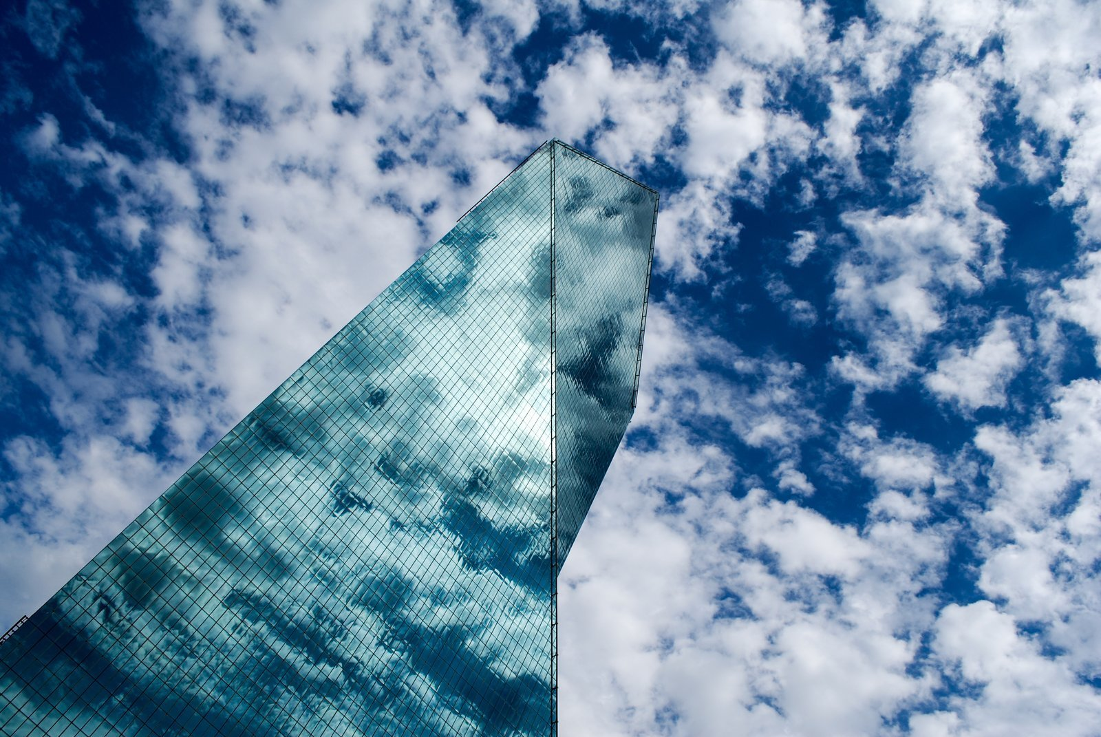"""I.M. Pei's Fountain Place is a 60-story modernist skyscraper in downtown Dallas, Texas. """"He used angles, triangles, planes, and prisms to create a seemingly impossible visual space with this building,"""" says photographer Nikola Olic, who took this image titled  Photo 3 of 12 in 10 I.M. Pei Buildings We Love"""