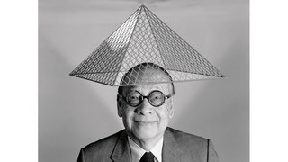 I.M. Pei with a model of Le Grand Louvre on his head.