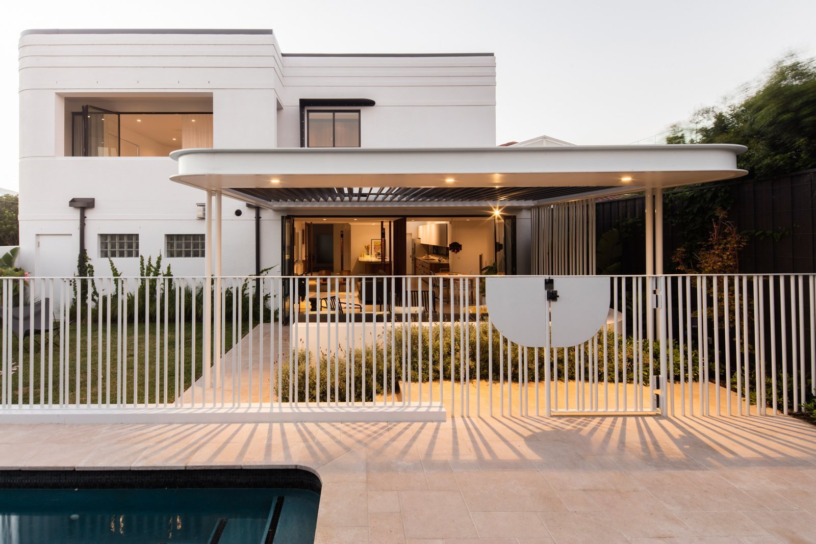 Outdoor, Front Yard, Trees, Stone Patio, Porch, Deck, and Metal Fences, Wall  Conway Atkins House from A Heritage Art Deco House in Australia Gets a Modern Update