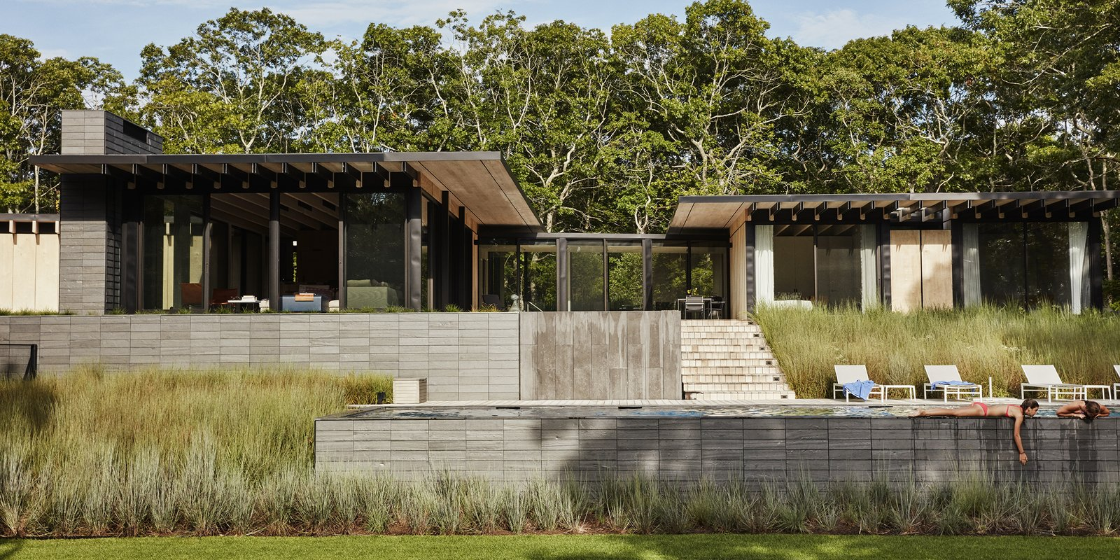 Exterior, Concrete Siding Material, and House Building Type  Photo 1 of 11 in A Family Retreat in the Hamptons Bridles Wind, Water, and Light