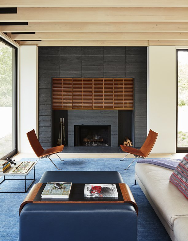 Living Room, Chair, Sofa, Coffee Tables, Ottomans, and Wood Burning Fireplace  Promised Land