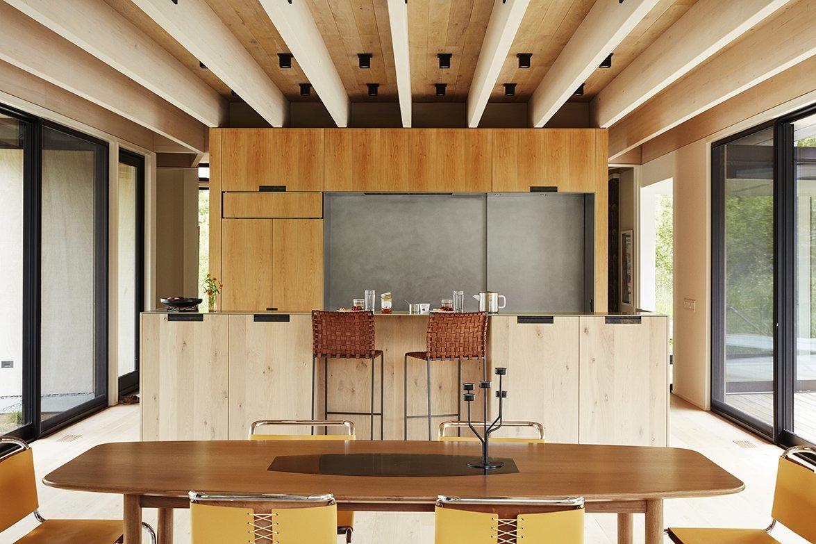 Kitchen, Light Hardwood Floor, Ceiling Lighting, Wood Cabinet, Refrigerator, and Cooktops  Promised Land