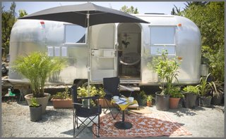 """""""I found the Airstream in the high desert of Anza, California, and thought it was a pure TLC job. Wishful thinking!"""" says interior designer Caroline Brandes, who also rents renovated Airstreams on her property in Big Sur through Big Sur Getaway. """"Even though the interior looked decent, once back home in Big Sur I had discovered water leaks, extensive floor rot under the linoleum tiles, and even frame damage."""" She hired Area 63 Productions, a professional Airstream renovation company, to help."""