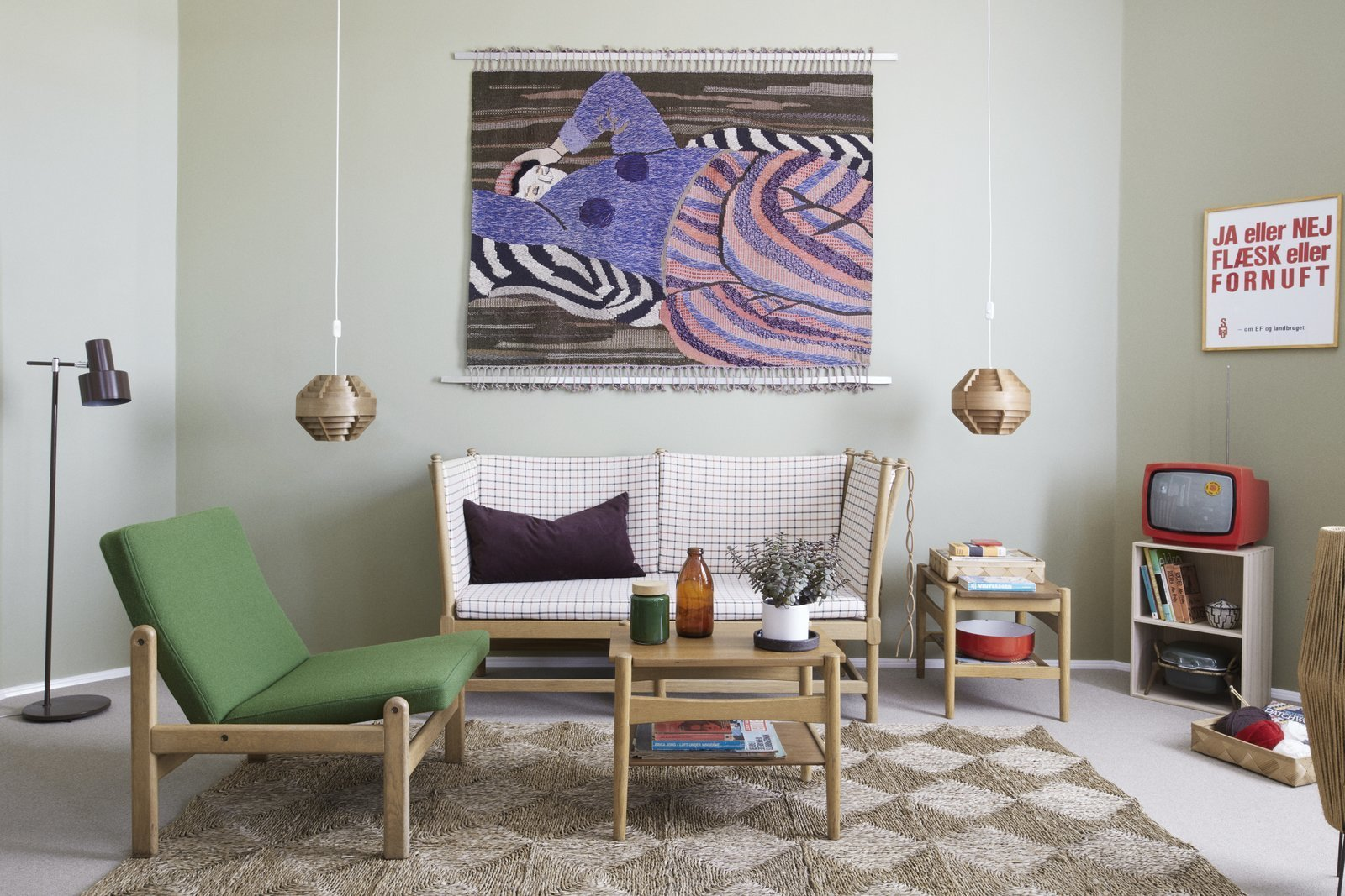 Living Room, End Tables, Chair, Coffee Tables, Rug Floor, Pendant Lighting, and Sofa  Photo 1 of 9 in Get Your Fix of Midcentury Scandinavian Design at This Copenhagen Hotel