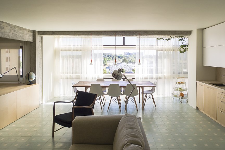 Dining Room, Table, Chair, Ceramic Tile Floor, and Pendant Lighting He also opted for light-colored materials, like seafoam-green cement tile by Projecto Mosaico and birch plywood millwork. - Lisbon, Portugal Dwell Magazine : July / August 2017  Photo 3 of 6 in Lisbon Vision