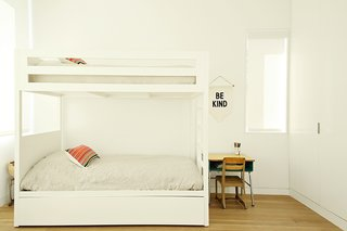 Lucas and Noah's bedroom holds a set of bunk beds by Urbangreen.