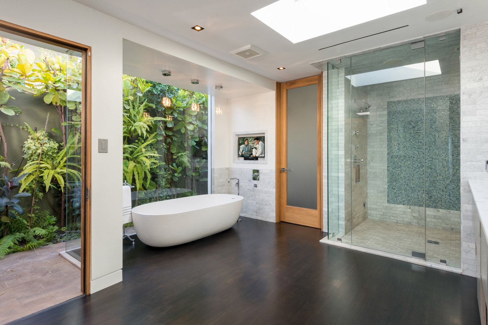 Bath, Freestanding, Ceiling, Dark Hardwood, Full, and Stone Tile  Bath Ceiling Dark Hardwood Photos from 'Friends' Star Matthew Perry's Midcentury Stunner in the Hollywood Hills Is For Sale