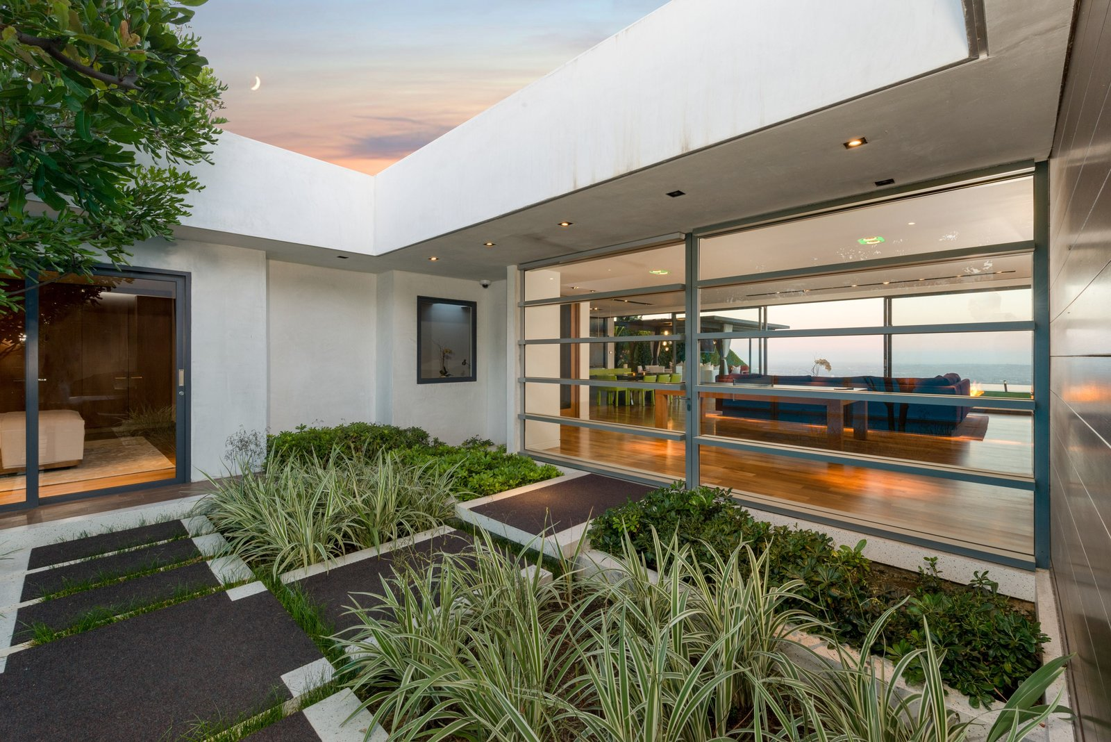 Outdoor, Front Yard, Shrubs, Hardscapes, and Pavers Patio, Porch, Deck  Hopen Place from 'Friends' Star Matthew Perry's Midcentury Stunner in the Hollywood Hills Is For Sale