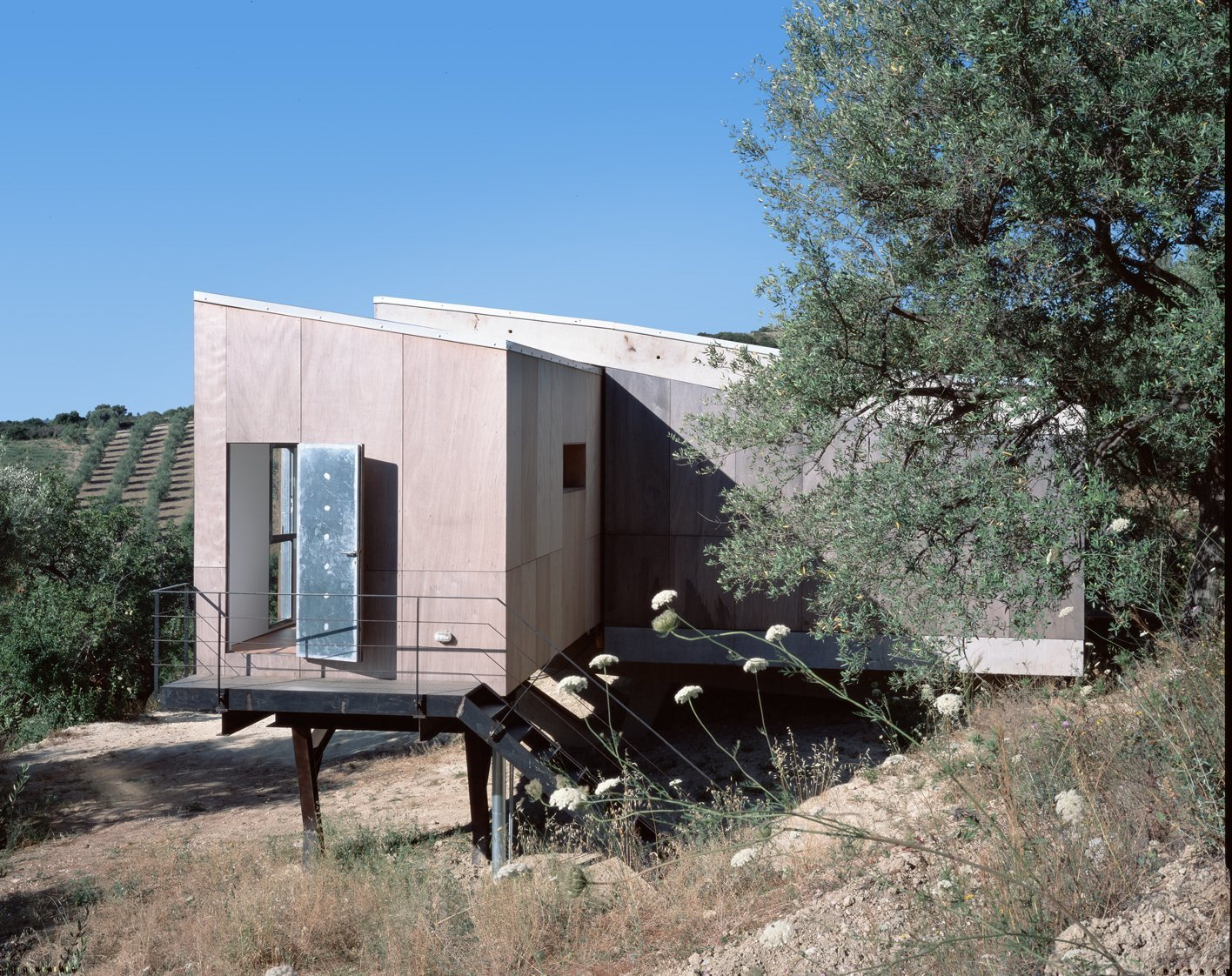 Exterior, House Building Type, Cabin Building Type, Wood Siding Material, and Shed RoofLine  Sea View Villa from Stay in a Minimalist Villa in the Sicilian Countryside, Complete With Sea Views