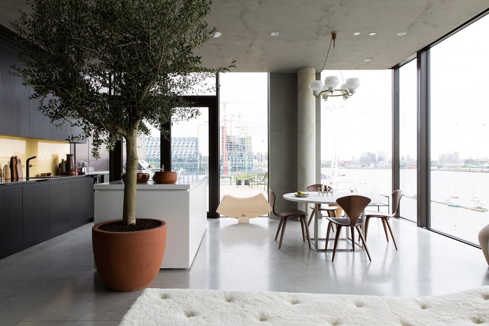 Dining Room, Table, Chair, Pendant Lighting, Concrete Floor, and Recessed Lighting  Photo 2 of 13 in For Just Under $2 Million, You Could Live in a London Penthouse Outfitted by Cereal Magazine