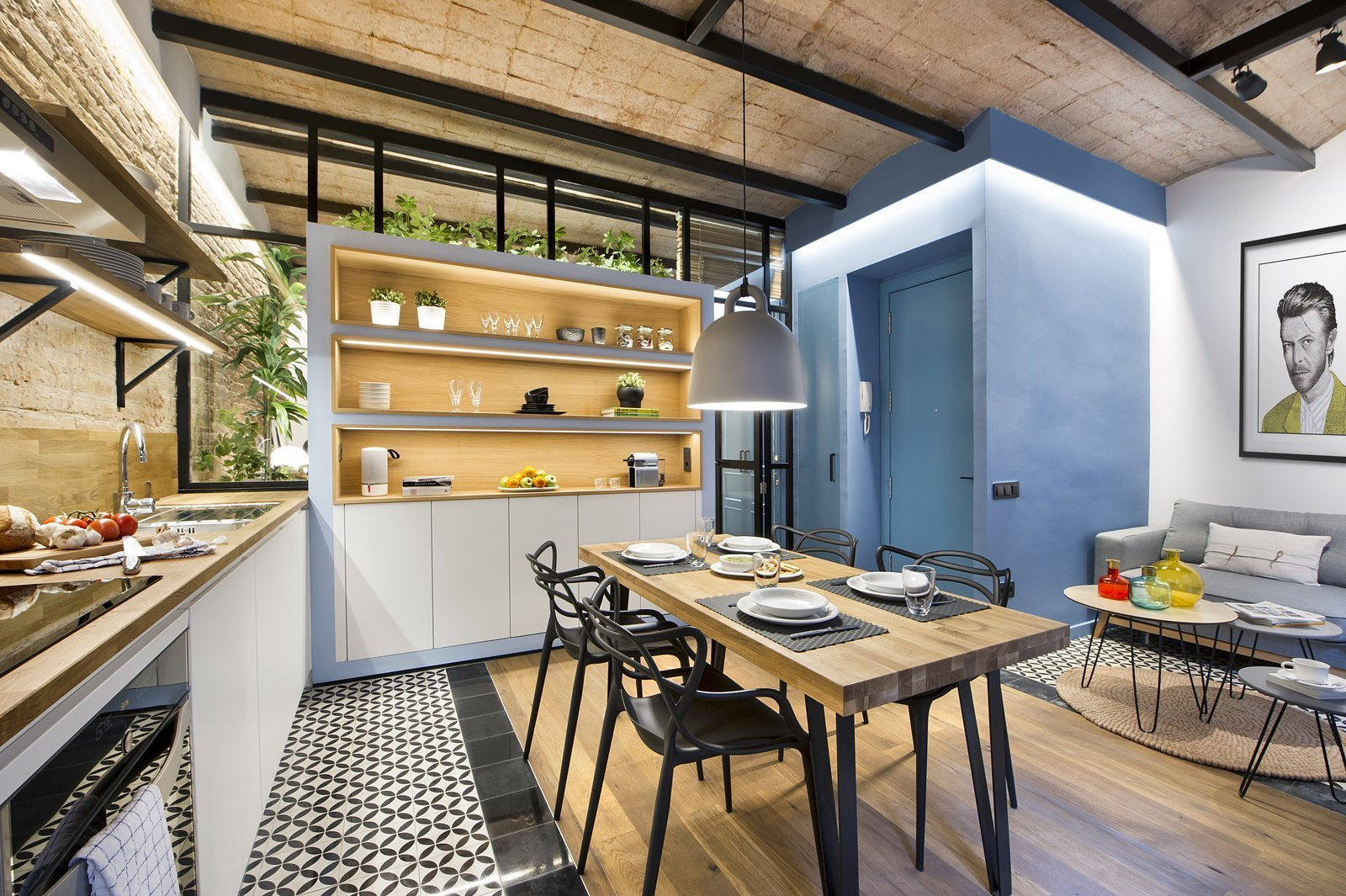 Dining Room, Chair, Pendant Lighting, Ceiling Lighting, Table, Light Hardwood Floor, and Ceramic Tile Floor  Photo 4 of 11 in A Smart Layout Maximizes Space in This Compact Urban Beach Apartment in Barcelona