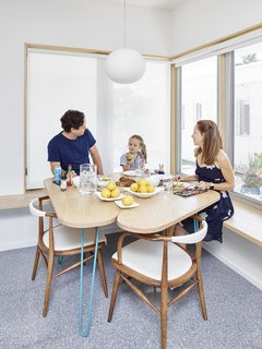 The tiles' forms inspired the soft, curving shapes of Gelpi's furniture designs, including an ash breakfast table, built by Nick Gilmore. With its views of the courtyard, Glo-Ball pendant by Jasper Morrison for Flos, and vintage chairs, this spot is a family favorite.