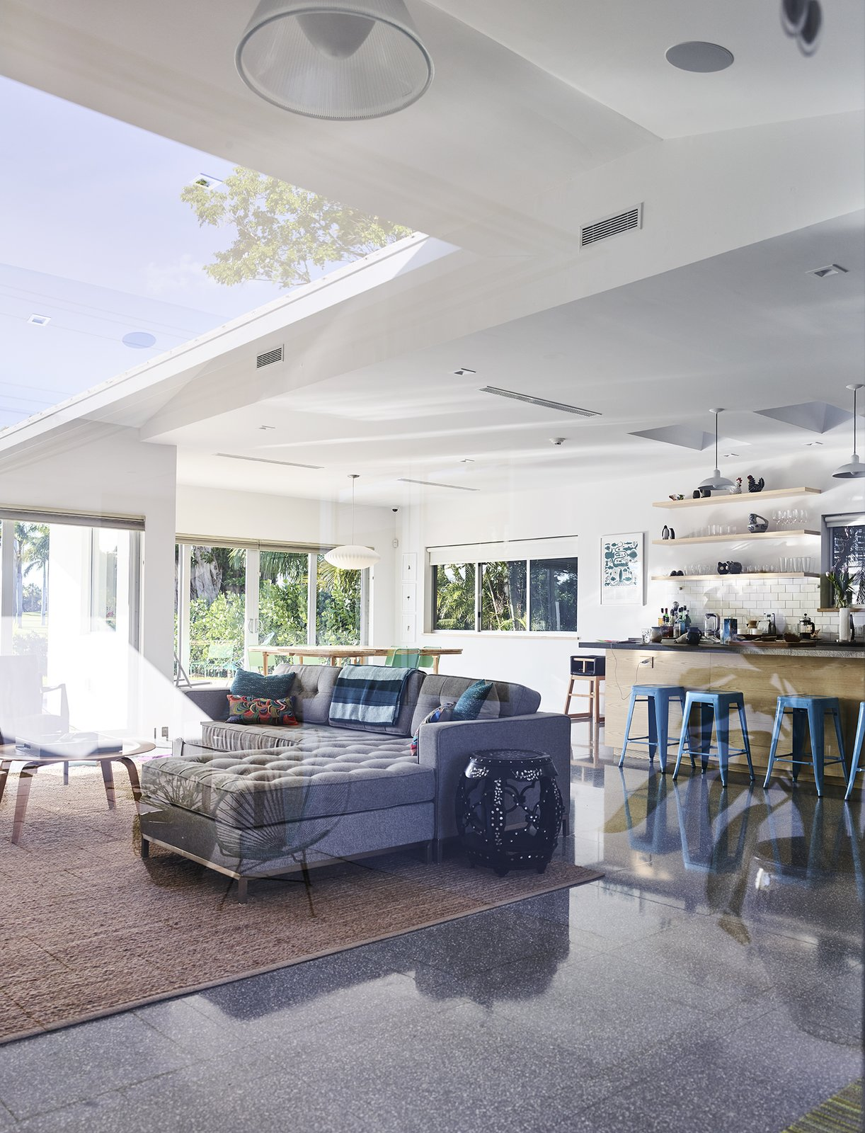 Living Room, Stools, Sofa, Ceiling Lighting, and Terrazzo Floor When the house's existing slab proved too damaged, Gelpi opted for a terrazzo floor tile by Perpetua in the same dimensions as the exterior tiles. - Miami, Florida Dwell Magazine : July / August 2017  Photo 7 of 12 in A Professor and Designer Tests a New Hybrid Material on His Miami Beach Home