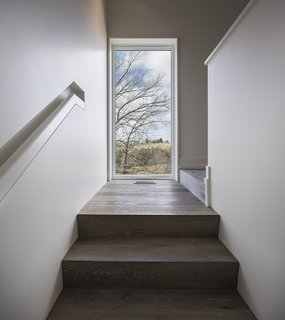 The flooring and stair treads are by Northern Wide Plank.