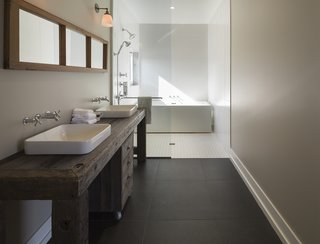 The master bathroom features sinks and fixtures by Kohler. The tub is by Aktuell.