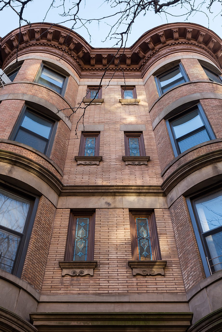 Exterior, House Building Type, and Brick Siding Material Stained-glass windows mark the facade  of the Park Slope building. - Brooklyn, New York Dwell Magazine : July / August 2017  Photo 12 of 13 in A Pair of Designers Renovate Their Brooklyn Brownstone With a Bright Monochromatic Palette