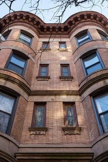 Stained-glass windows mark the facade of the Park Slope building.
