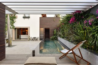 An Architect Renovates His 1920s Home in Portugal, While Preserving the Exterior Shell