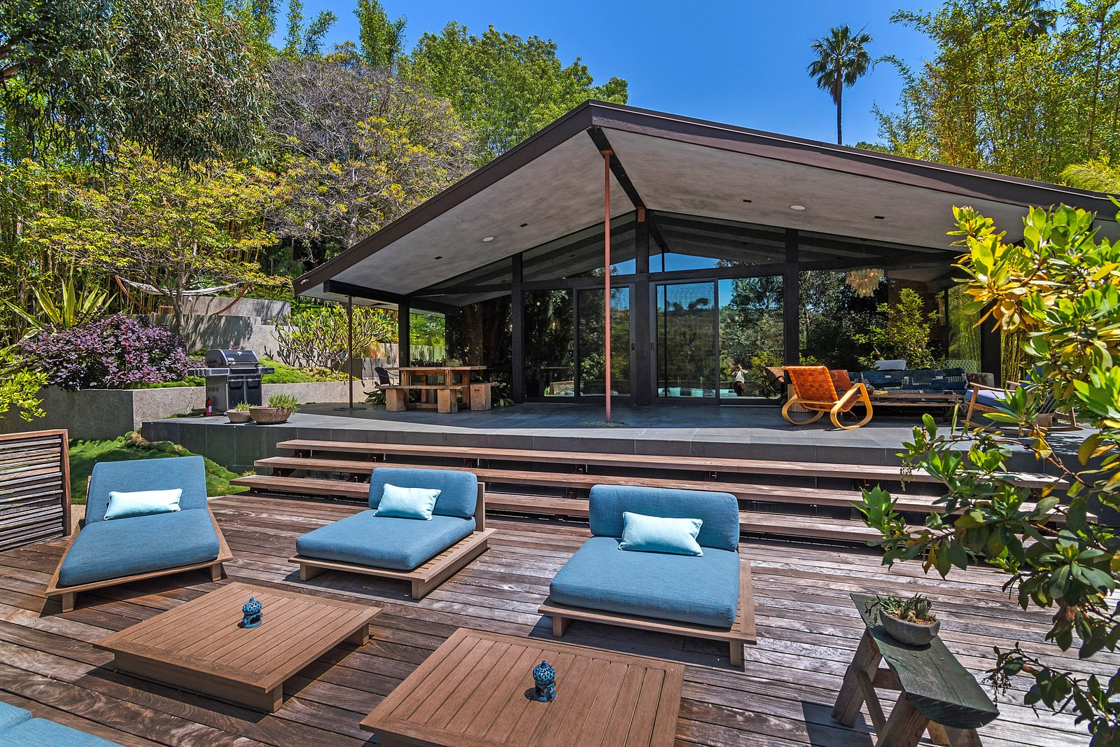Tagged: Outdoor, Large Patio, Porch, Deck, Back Yard, Wood Patio, Porch, Deck, and Trees.  Photo 13 of 14 in John Legend and Chrissy Teigen's Former Midcentury Home in the Hollywood Hills Is For Sale