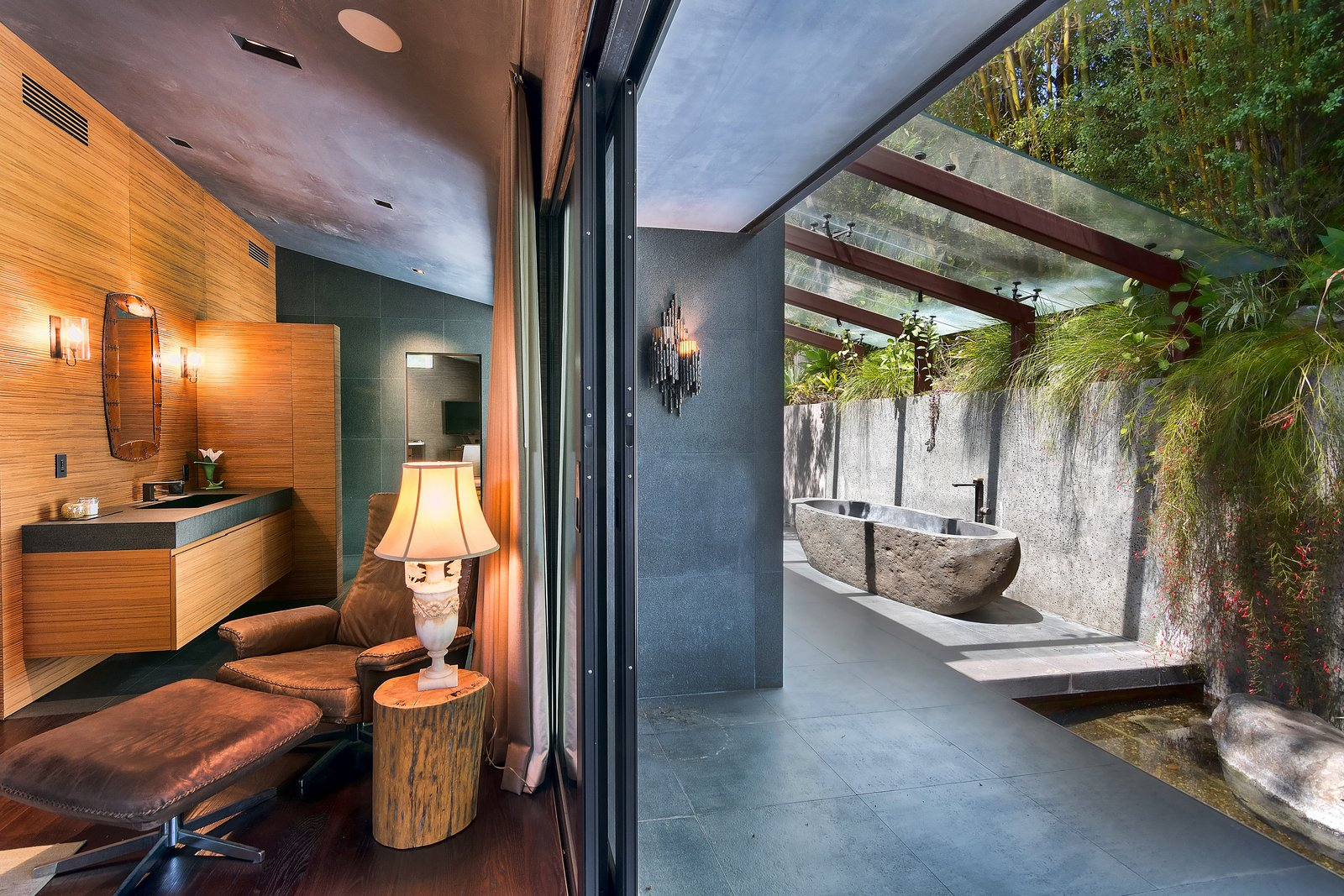 Bath Room, Wall Lighting, Freestanding Tub, Soaking Tub, Drop In Sink, and Recessed Lighting  Photo 10 of 14 in John Legend and Chrissy Teigen's Former Midcentury Home in the Hollywood Hills Is For Sale