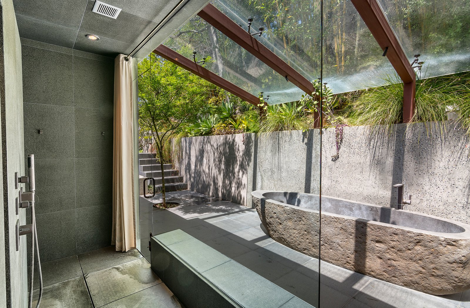 Bath Room, Freestanding Tub, Soaking Tub, Open Shower, and Ceiling Lighting  Photo 9 of 14 in John Legend and Chrissy Teigen's Former Midcentury Home in the Hollywood Hills Is For Sale