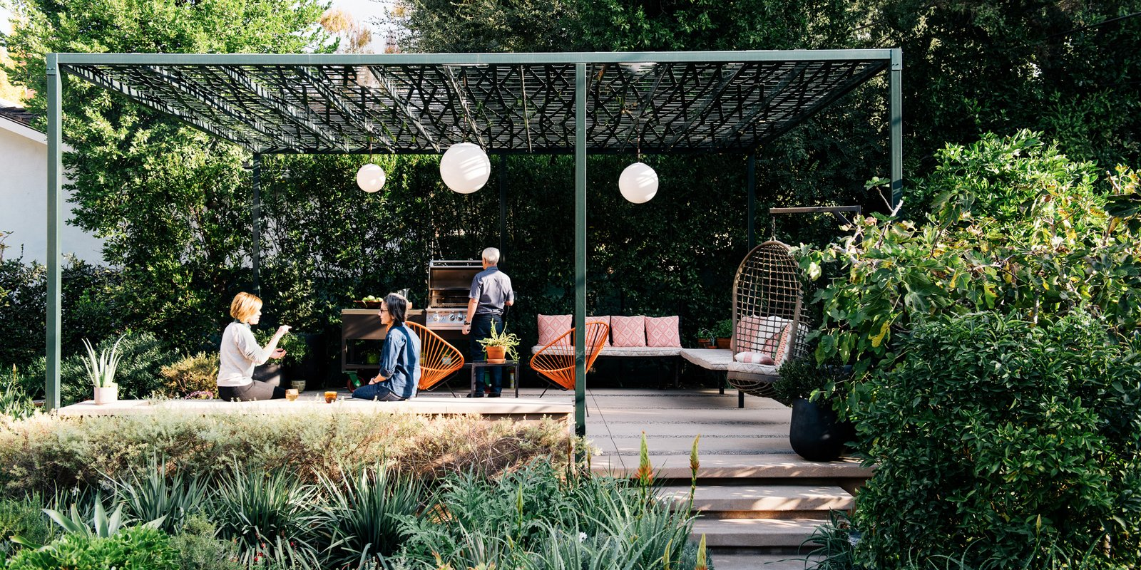 Outdoor, Back Yard, Side Yard, Trees, Boulders, Stone Patio, Porch, Deck, Hanging Lighting, and Walkways  Photo 1 of 9 in A Laser-Cut Pergola Completes a Tranquil Garden in L.A. That's Perfect For Entertaining