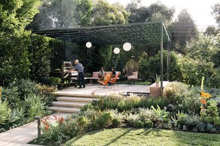 "A laser-cut metal pergola anchors a tranquil garden near Los Angeles. While studying silk-screening in college, Lillian Montalvo was encouraged to test the limits of her imagination. She obliged, throwing dry spaghetti onto a table and watching as the pieces fell into a pleasing arrangement. That linear pattern, which she says evoked the ""randomness"" of nature, stuck with her."