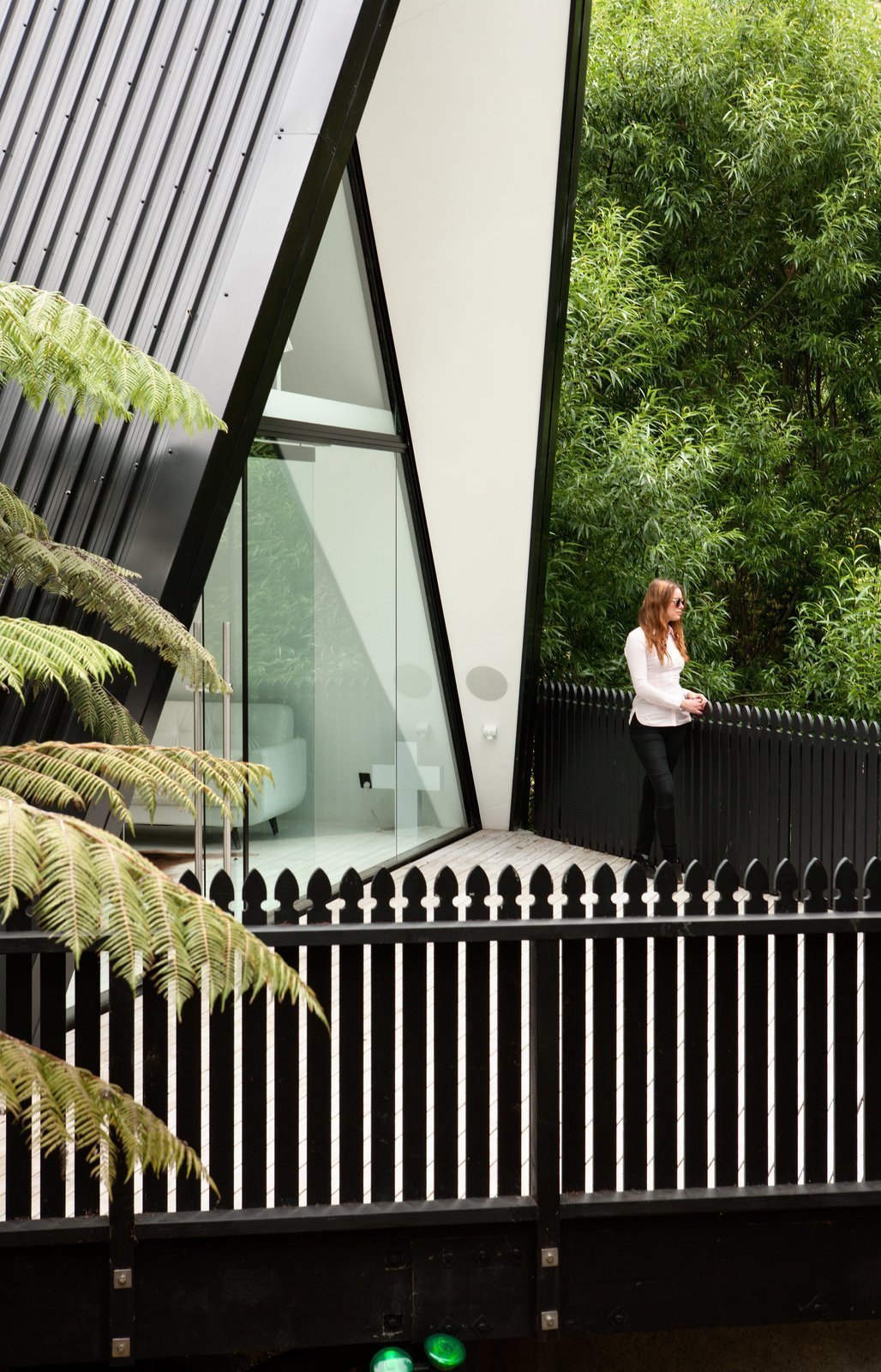 Outdoor, Front Yard, Small Patio, Porch, Deck, Trees, Wood Patio, Porch, Deck, Wood Fences, Wall, and Vertical Fences, Wall  Photo 3 of 8 in Stay in a Tent-Inspired A-Frame Cabin in the New Zealand Rain Forest