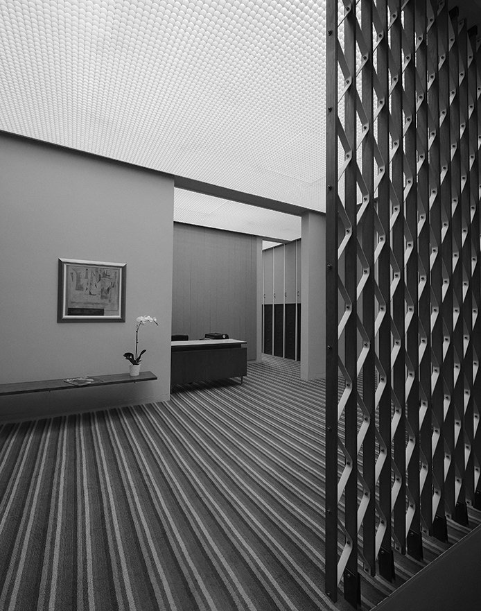 The screen in the office is made of teak strips and steel zig-zags. - Columbus, Indiana Dwell Magazine : July / August 2017  Photo 14 of 19 in Ode to a Forward-Thinking America: Columbus, Indiana