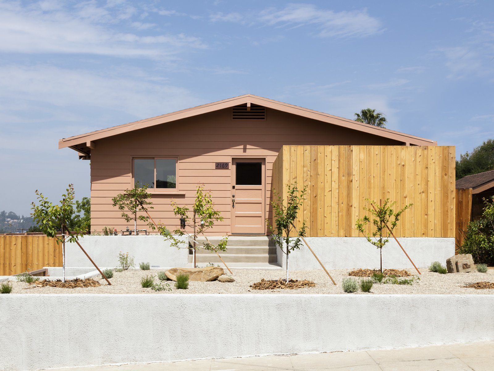 Outdoor, Vertical Fences, Wall, Wood Fences, Wall, Front Yard, Hardscapes, and Boulders  Photo 2 of 14 in Grids and Colors Inspire the Renovation of a Graphic Designer's Pink L.A. Bungalow