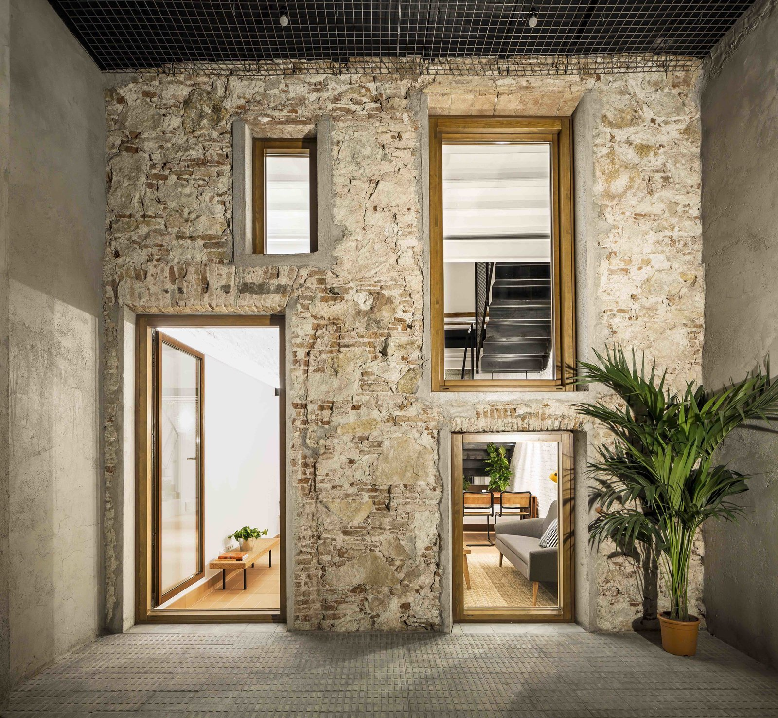 Back Yard, Small, Exterior, and Brick  Best Exterior Small Photos from This Double-Height Apartment in   Barcelona Features Historic Details and a Floating Staircase