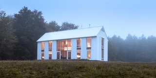 A Louis Kahn–Inspired Barn That's Lined With Floor-to-Ceiling Shutters